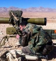Quân đội Syria bỏ vũ khí chạy thoát thân