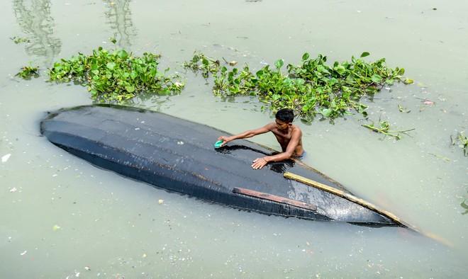 24h qua ảnh: Du khách xem thủy triều trên sông Tiền Đường - Ảnh 5.